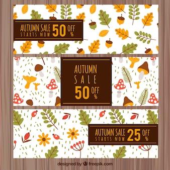 Banners de rebajas de otoño con hojas, setas y bellotas