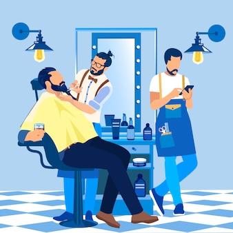 Barber styling client beard en salon barbershop