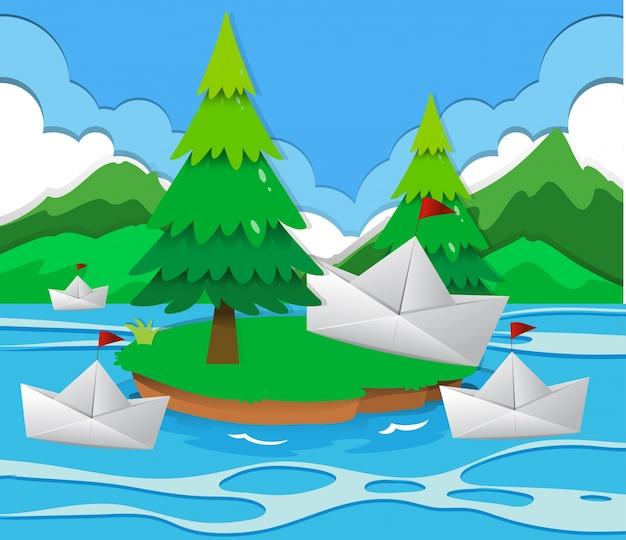 Barcos de papel flotando en el lago