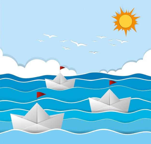 Barcos de origami que navegan en el mar