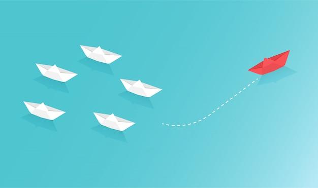 Los barcos de papel representan el trabajo en equipo empresarial y una idea de concepto creativo de visión diferente.
