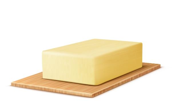 Barra de mantequilla amarilla en la tabla de cortar, margarina o extensión, producto lácteo natural