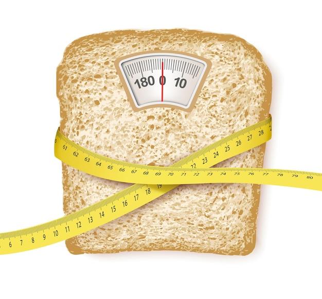 Báscula en forma de rebanada de pan y cinta métrica. concepto de dieta