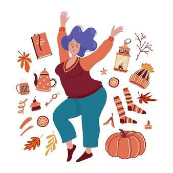 Bastante joven mujer gordita rodeada de objetos asociados de otoño: calcetines, calabaza, linterna, té, libro, hojas, celebración de otoño
