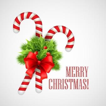 Bastón de caramelo de navidad con acebo y lazo rojo, tarjeta de felicitación.