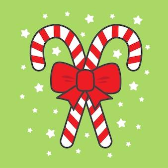 Bastón de caramelo navideño con cinta roja y estrellas
