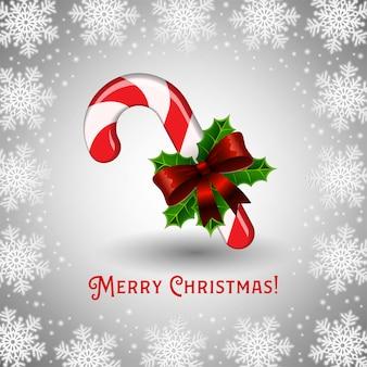 Bastón de caramelo y saludo de feliz navidad