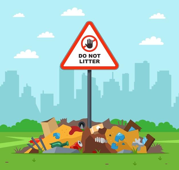 Basura en el lugar equivocado. señal de advertencia no tirar basura. violación de la ley en la naturaleza.