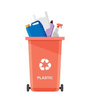 Basura plástica surtida en urna especial. reciclar el concepto. papelera para reciclaje con basura y desperdicios clasificados.