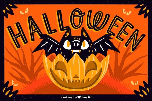 Bat en un fondo de calabaza de halloween