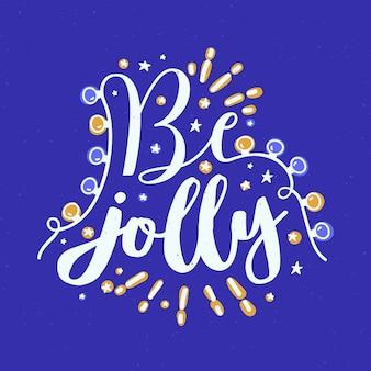 Be jolly holiday wish escrito con fuente caligráfica cursiva y decorado con guirnaldas de luces brillantes