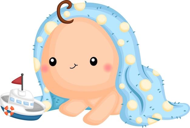 Un bebé envuelto en una toalla buscando un juguete.