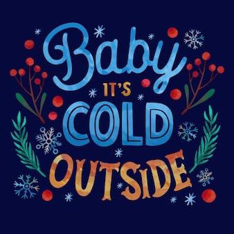 Bebé hace frío fuera de letras sobre fondo de invierno