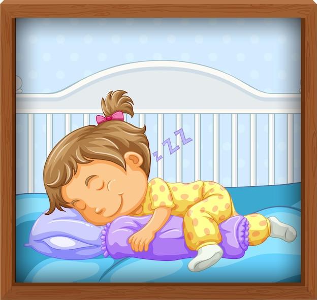 Bebé niña duerme en la cuna del bebé
