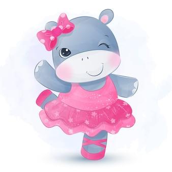 Bebé niña hipopótamo con vestido de bailarina y bailando alegremente