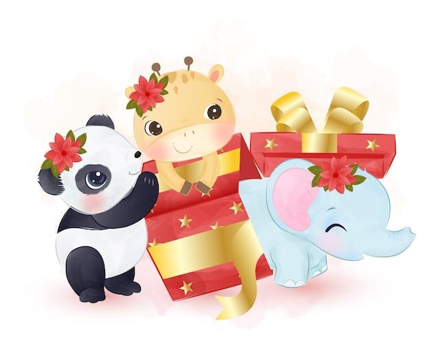 Bebé panda, jirafa y elefante jugando con caja navideña