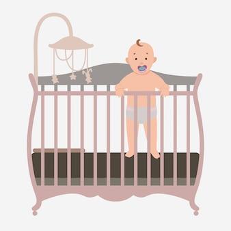 Bebé de pie está en la cuna.