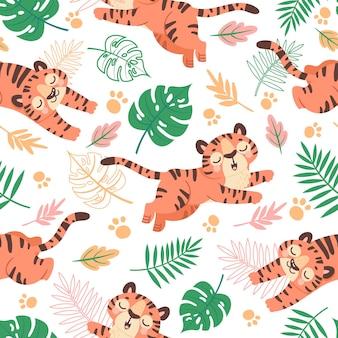 Bebé tigre de patrones sin fisuras. tigres de dibujos animados infantiles, pata y hojas tropicales. animales de la selva, gatos salvajes, papel tapiz de vector para niños. fondo de pantalla de patrón con tigre, ilustración de fondo infantil de bebé