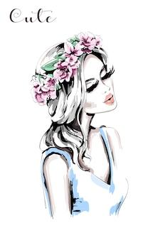 Bella mujer con corona de flores en el pelo