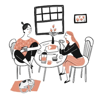 Una bella mujer sentada y desayunando