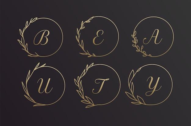 Belleza conjunto de diseño de marco de logotipo de corona de flores de alfabeto dibujado a mano negro y dorado