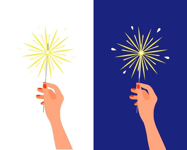 Bengala bengala de fuego ligero en mano femenina. fuegos artificiales de navidad año nuevo cumpleaños, pirotecnia de vacaciones, saludo de celebración aislado sobre fondo blanco.