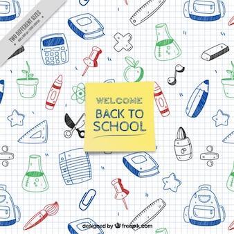 Bienvenido al colegio con materiales escolares dibujados en un cuaderno