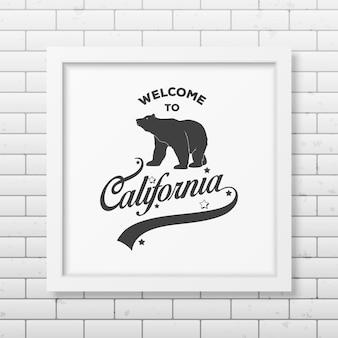 Bienvenido a california - marco blanco cuadrado realista tipográfico en la pared de ladrillo.