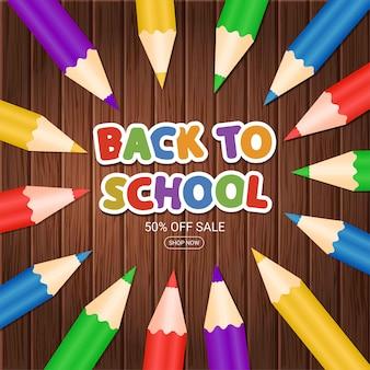 Bienvenido de nuevo al colegio. cartel con lápices de colores y frase sobre fondo de madera. banner de venta