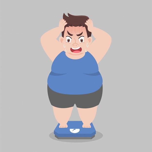 Big fat man parado sobre balanzas electrónicas para peso peso corporal