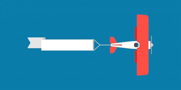 Biplano rojo con la ilustración de la bandera de la cinta de aire.