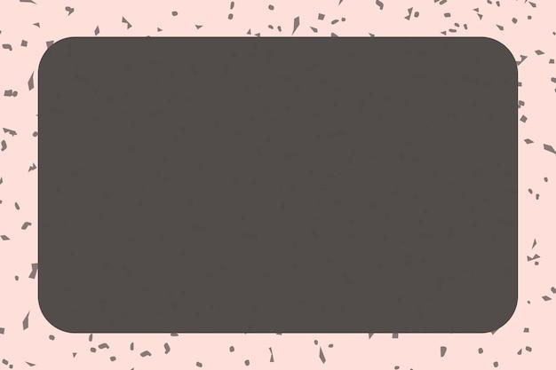 Bloc de notas marrón sobre rosa