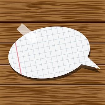 Bocadillo de diálogo de papel sobre una textura de madera