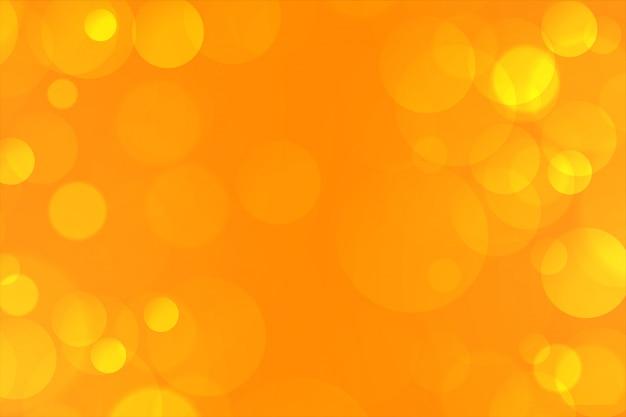 Bokeh elegante amarillo enciende el fondo encantador