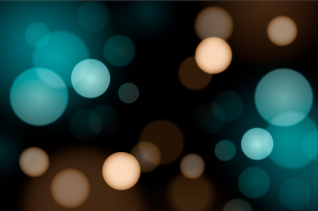 Bokeh gradiente luces azules sobre fondo oscuro