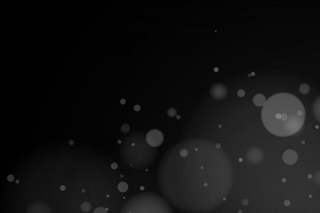 Bokeh de luces blancas en la oscuridad