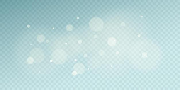 Bokeh de luces claras aislado sobre fondo azul transparente. manchas naturales borrosas. efecto de luz