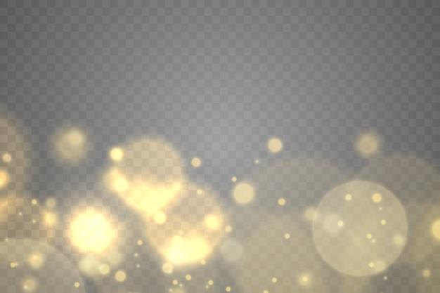 Bokeh de partículas de polvo mágico dorado brillante sobre fondo transparente, efecto de luz, brillo, luces brillantes, chispas de polvo amarillo y brillo de estrellas con luz especial.