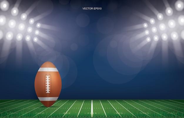 Bola del balompié en fondo del estadio del campo de fútbol.