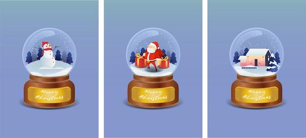 Bola de cristal de navidad con muñeco de nieve, papá noel y casa en paisaje de invierno