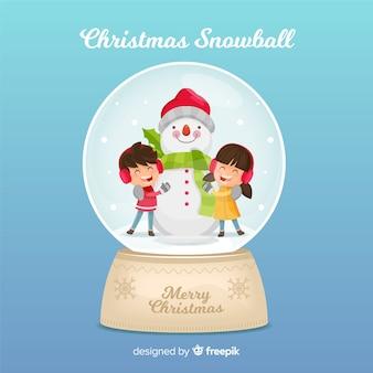Bola de nieve de cristal con niños