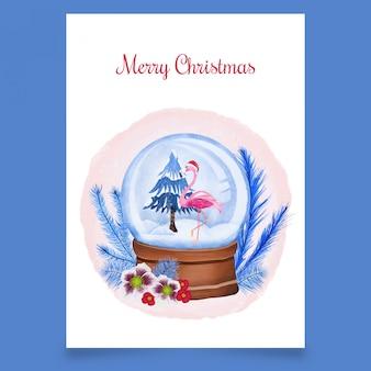 Bola de nieve de navidad con flamenco rosado y árbol