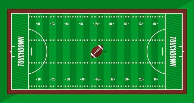 Bola y vista superior del campo verde de fútbol americano