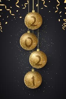 Bolas de navidad brillantes con números de año nuevo y confeti volador. cepillo de grunge.