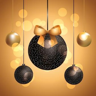Bolas de navidad doradas y negras con cintas colgando