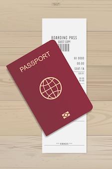 Boleto de pasaporte y tarjeta de embarque sobre fondo de madera