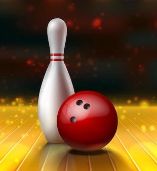 Bolos kegel y bola roja sobre un piso de madera.