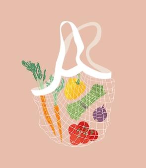 Bolsa de compras de redes de algodón de concepto ecológico con verduras frescas