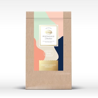 Bolsa de papel artesanal con etiqueta de pistachos y chocolate.