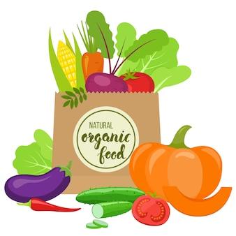 Bolsa de papel con vegetales coloridos.
